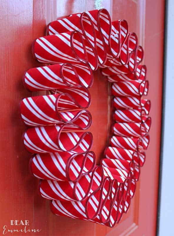 red and white ruffled ribbon front door christmas wreath