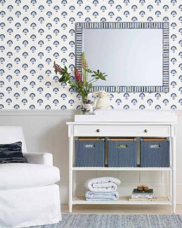 cane shelved baby changing table from Serena & Lily in coastal nursery / nautical nursery