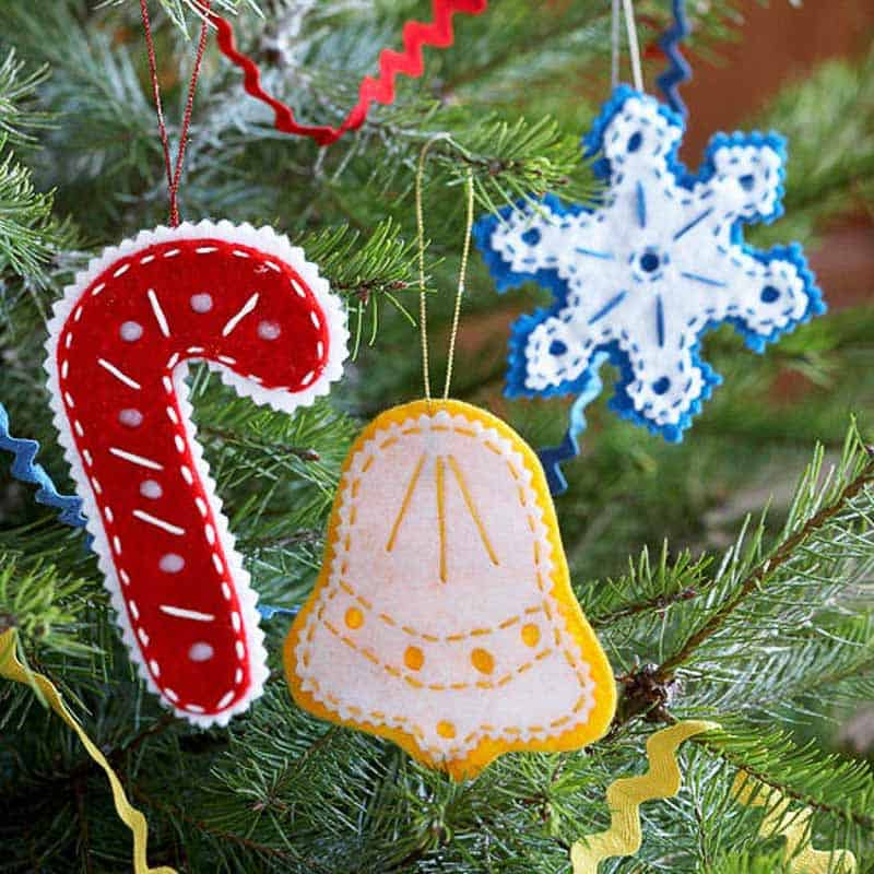red candy cane, yellow bell and blue snowflake felt Christmas ornaments