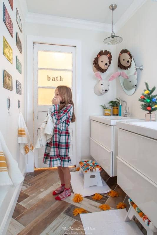 The DIY kids' bathroom halls are decked for the holidays! Check out this $1800 full bathroom renovation project!