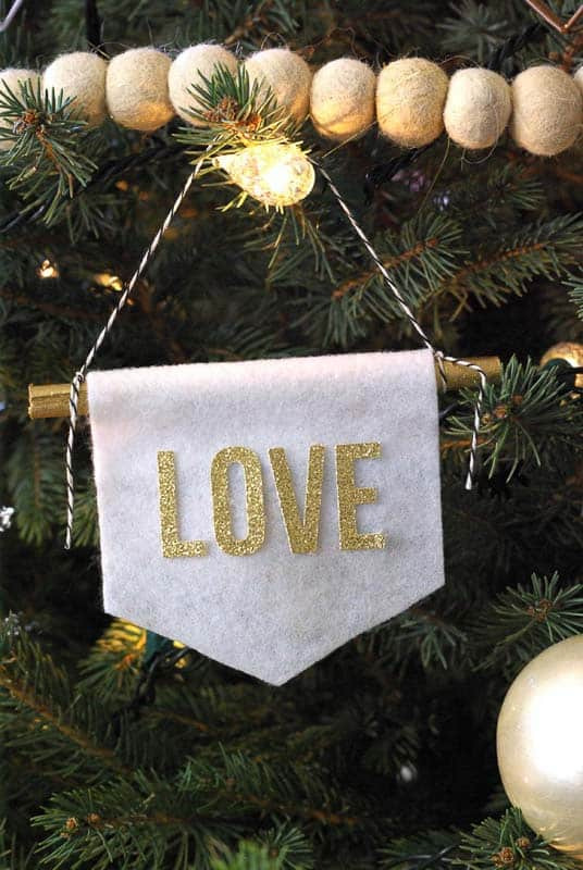"""white banner with gold letters """"love""""felt Christmas ornaments"""