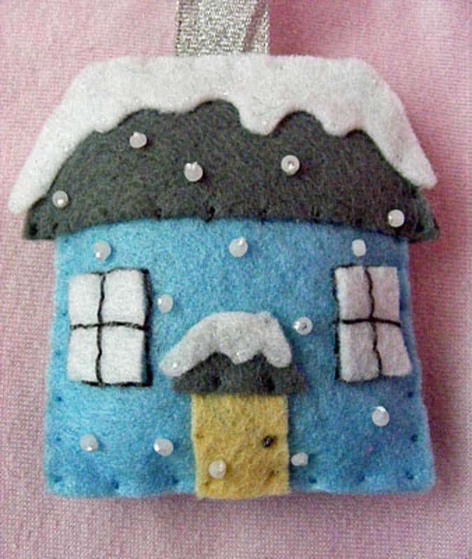 winter house with snowflakes and snow covered roof felt Christmas ornaments