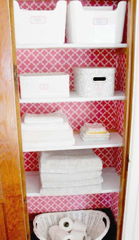 Closet Organizer Ideas: Bling the back of your closet with wallpaper & use matching, labeled storage baskets to control clutter