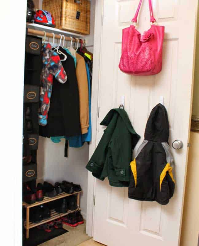 Closet Organizer Ideas: A multi-tier shoe rack is helpful. And don't forget to use space on the back of the door!