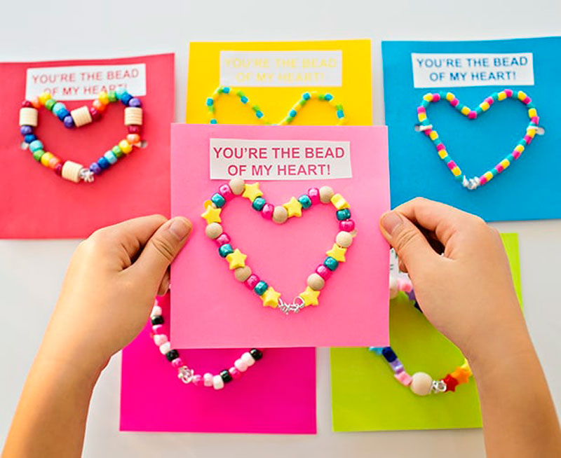 """valentines day card ideas: beaded bracelet gift attached to printable card """"you're the bead of my heart"""""""
