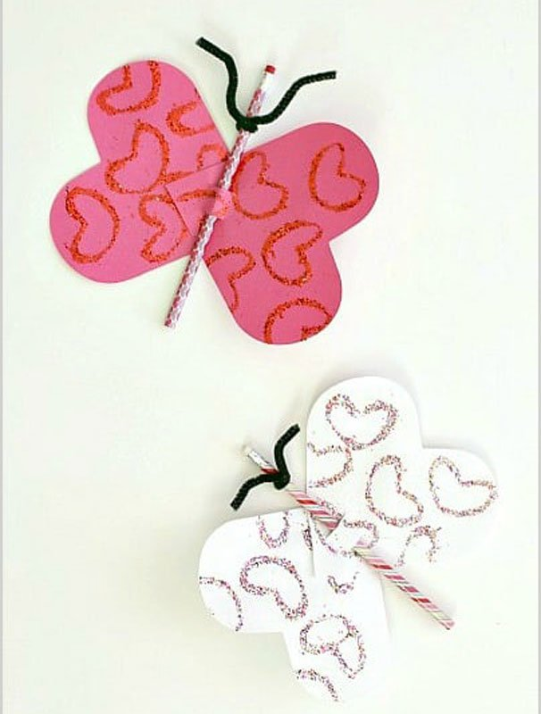 valentines day card ideas: butterfly made from pencil, pipe cleaner and two heart-shaped pieces of paper