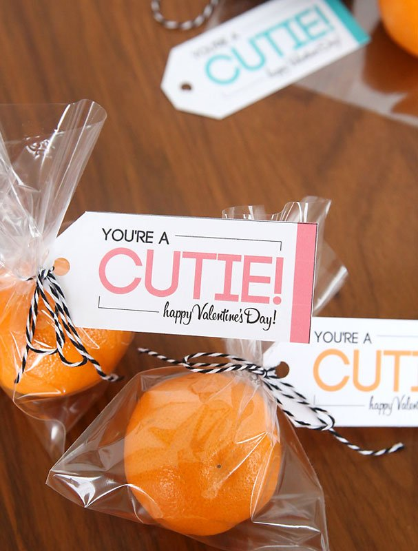 """cutie oranges in cellophane wrapper with attached card """"you're a cutie"""""""