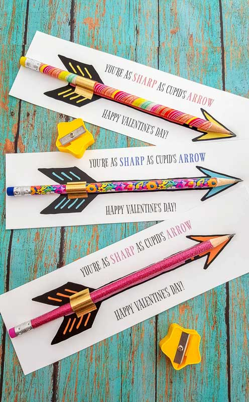 """valentines day card ideas: pencil taped to printable """"you're as sharp as cupid's arrow"""" with pencil on top of an arrow graphic"""