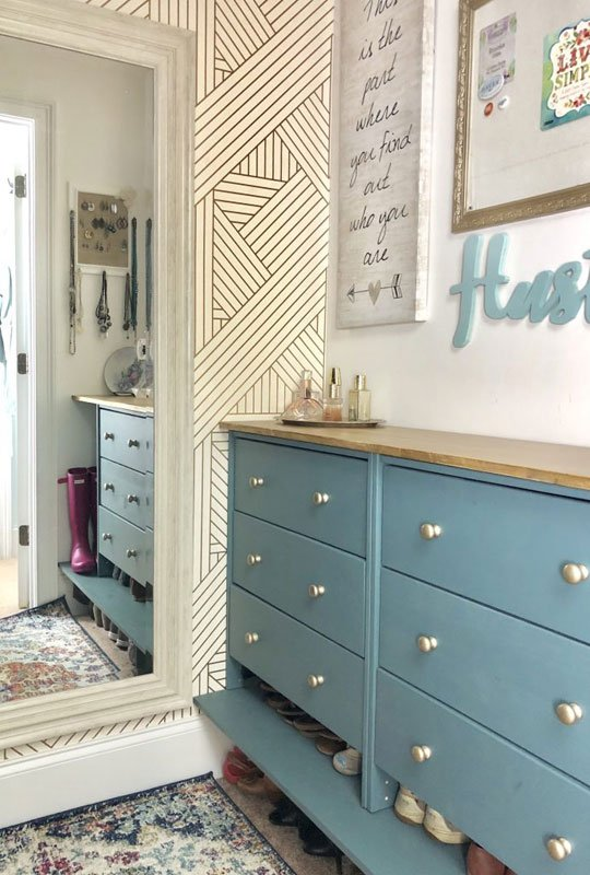 Closet Organizer Ideas: Beautiful closet makeover inspiration with custom blue dresser used for storage and bold accent wall