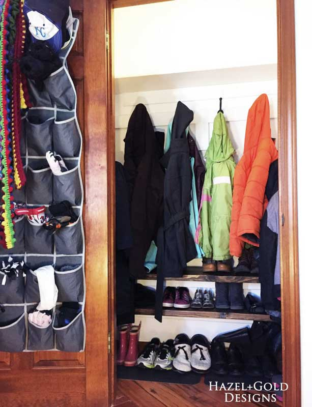 Small closets should use every square inch of space in a purposeful way, including stacked levels of shoes and back of the doorway hangers for seasonal items