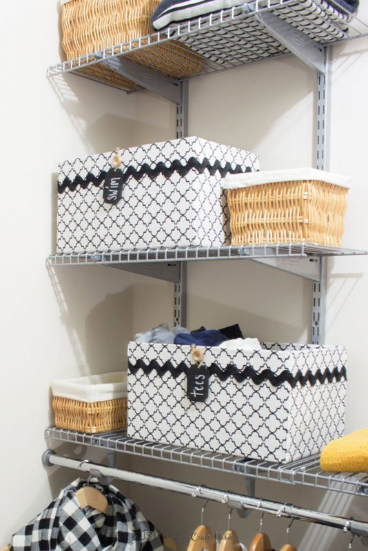 Closet Storage Ideas: Cardboard boxes upcycled into beautiful storage boxes sitting on wire shelving