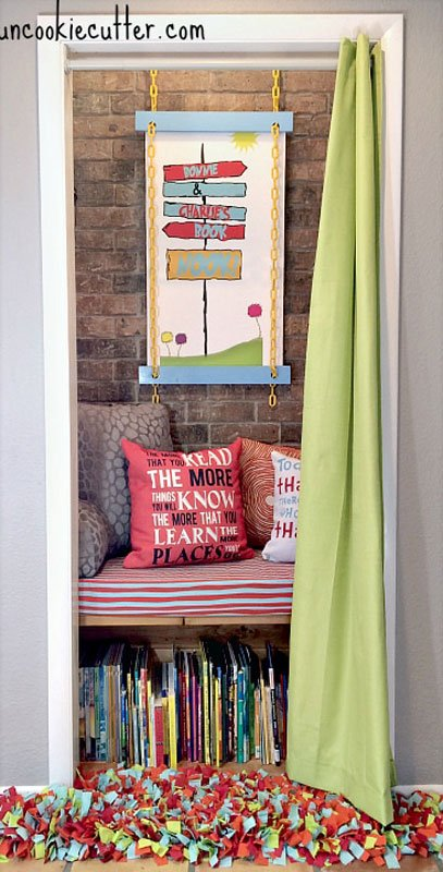 "A great closet conversion project. A small closet reimagined into a gorgeous reading nook for a child with Built in reading bench, and the library sitting in shelving under the bench. A curtain serves as a ""door"" that the child can close for quiet time."