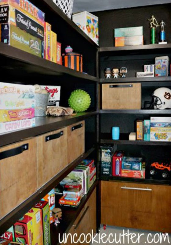 Closet Organizer Ideas: Dedicate a toy and game closet like this one with bins for odd shaped toys and open shelving for board games.