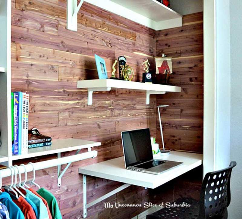 Closet Organizer Ideas: Steal space from a larger closet to create a work space, command center or desk area. This one has open shelving, a hanging rack, and planked cedar wall.