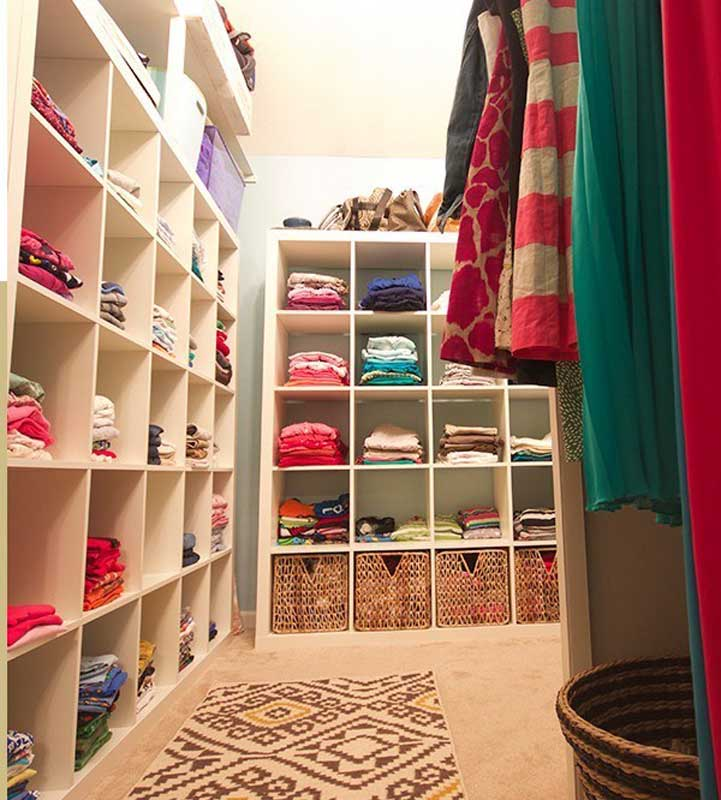 Closet Organizer Ideas: cubbies are great for keeping multiple family members items stored neatly as this one does in their family closet.