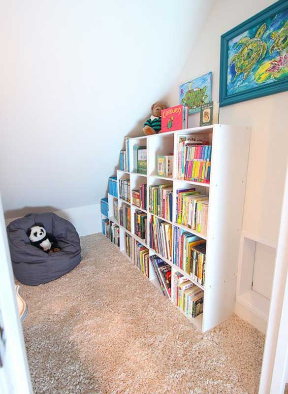 Closet under roof line converted into a reading nook for children.