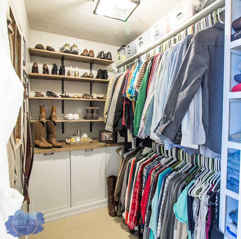 Integrated laundry baskets inside a walk-in closet/dressing room keep clutter in check. Open shelving for shoes gets them off the ground and keeps them organized.