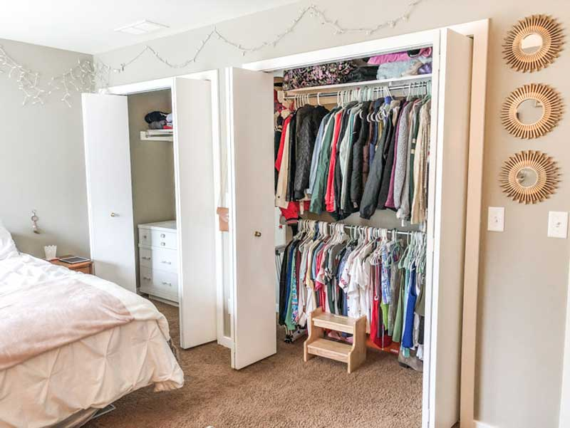 Closet Organizing Tips for teens! A teen closet with a set of double bi-fold door is reorganized with double hanging bar, and a dresser inside the closet.
