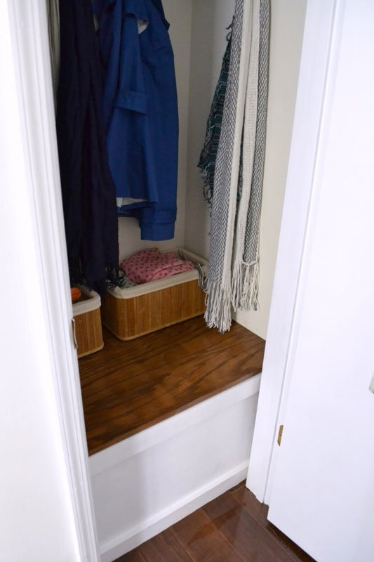 Create a built-in storage bin in a closet to store odd shaped items like pillows.