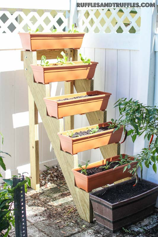 Smart and easy multi-tiered vertical garden made from a stair stringer.