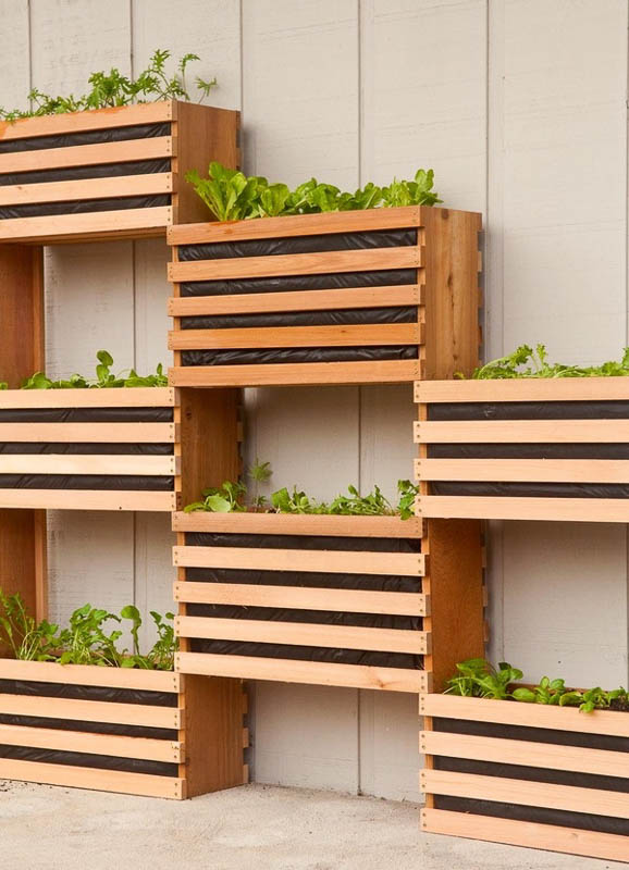 DIY free-standing vertical wall garden that looks like crates attached to each other