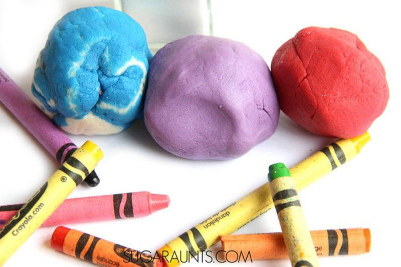 Easy Salt Dough Recipe to Make Colorful Dough with Crayons. Great to make ornaments out of. Image of three balls of salt dough in vibrant crayon colors.