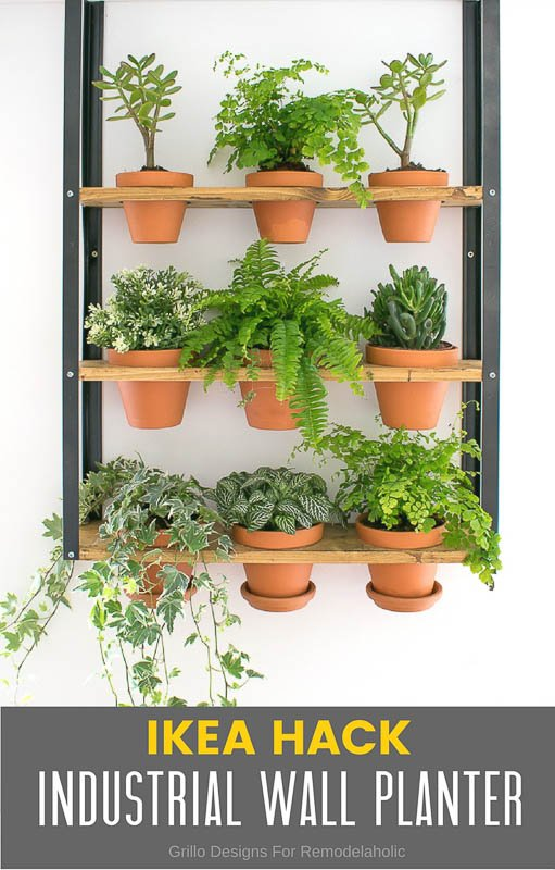 An industrial chic vertical garden Ikea hack with metal and wood shelving and terra cotta potted plants