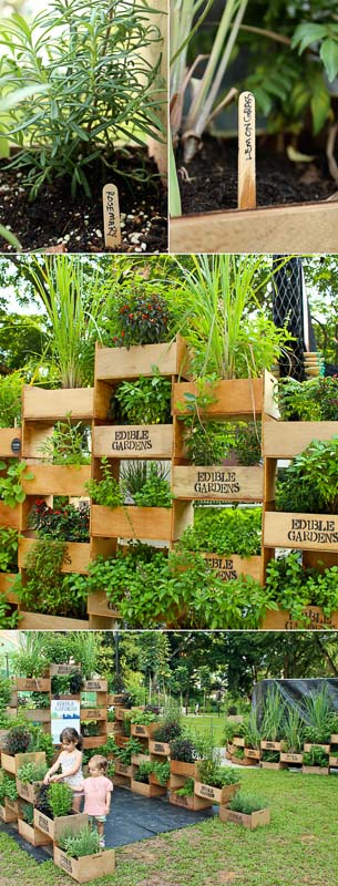 Beautiful free-standing, large scale vertical gardens at a park with trough style/crate wood planters, popsicle stick garden markers and labels on wood crates done with wood burning tool