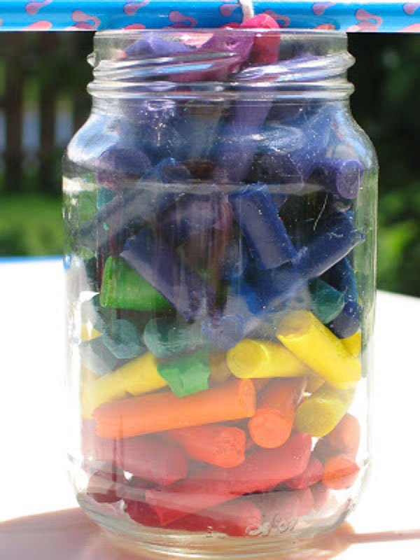 What a fun, colorful way to repurpose crayons! Make a mason jar candle using old crayons