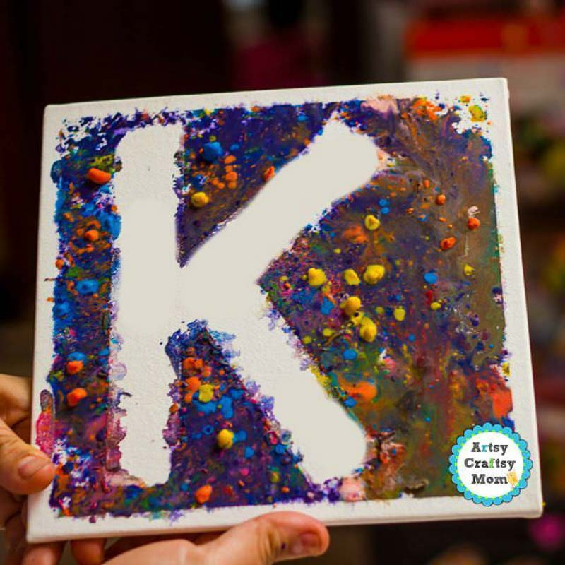 "Completed DIY monogram canvas with melted crayons and the letter ""K"""