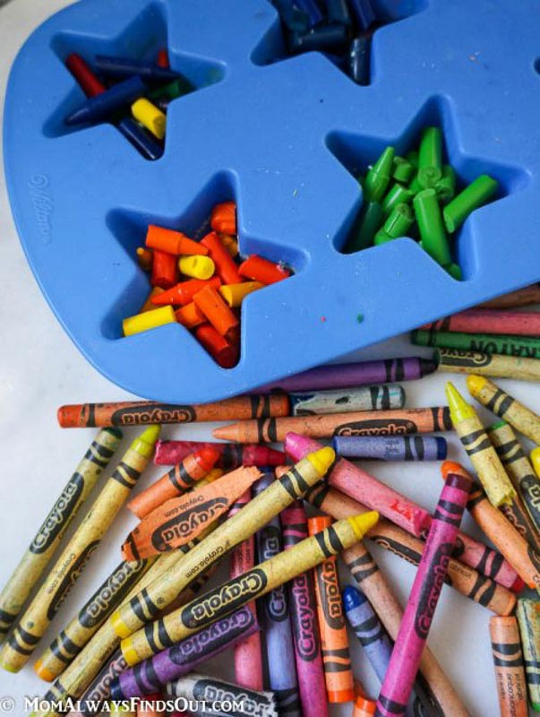 Recycle crayons with this fun melted crayon craft. make crayons in the shape of stars. image of crayon pieces in a silicone star shaped mold.