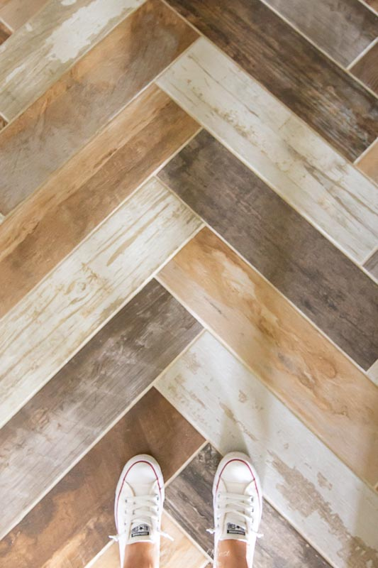 Wood Look Tile installed in a bathroom in a herringbone/chevron pattern