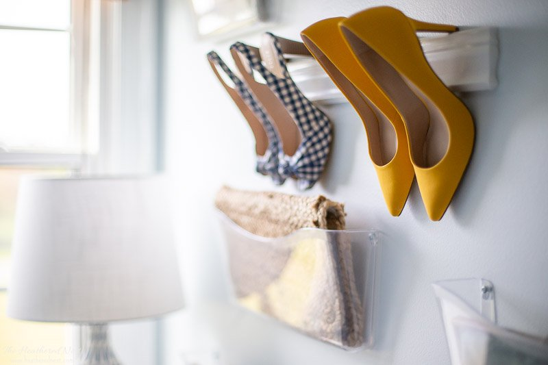Easy DIY purse organizer | completed showing one handbag and two pairs of heels being stored and displayed beautifully on the wall!