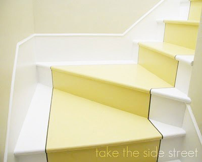 yellow and white painted stairs with black trim | remodelaholic