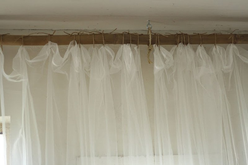 DIY Curtain Rods | Cassie Bustamante DIY bamboo rood with jute curtain ties