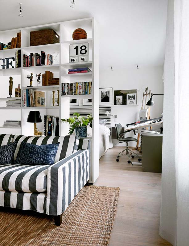 30+ Amazing Room Divider Ideas | Strategically positioned freestanding bookcase as a room divider skonahem.com