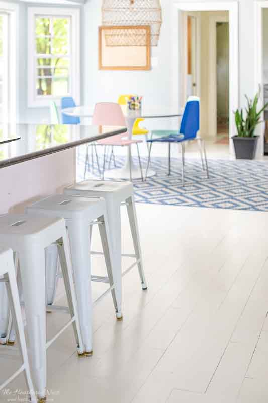 all about painting hardwood floors | finished white painted floors in kitchen/kitchenette area
