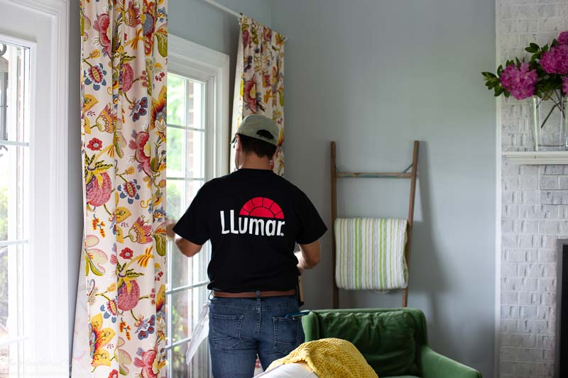 Llumar window film being installed in our family room