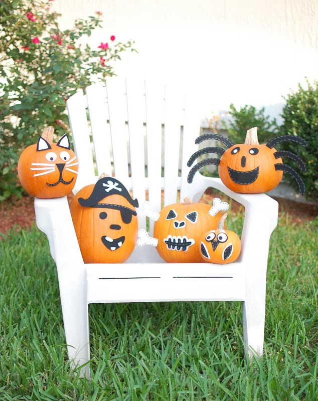 pumpkins embellished with construction paper to look like a spider, skeleton, cat, owl and pirate
