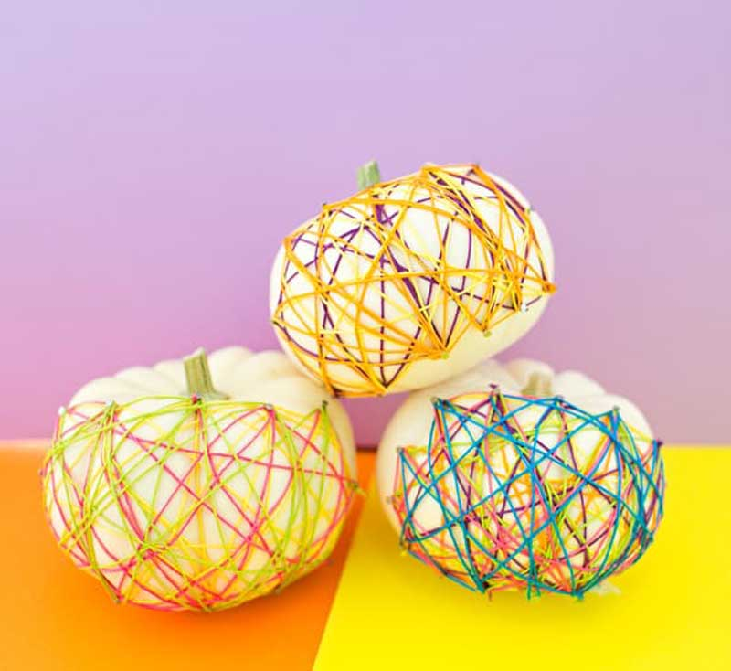 pumpkins covered with colorful string art