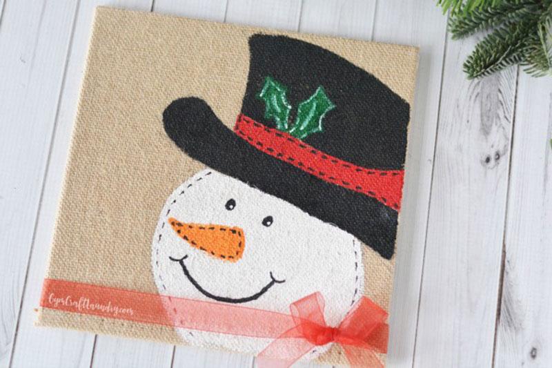 Snowman craft on white wood background