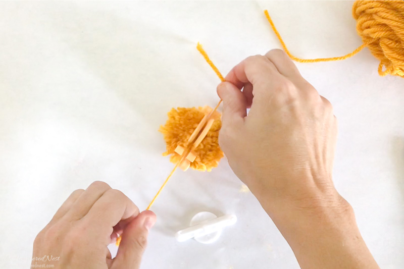 how to make yarn pom poms with a pom pom maker - step-by-step tutorial