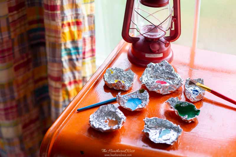 Acrylic paints in tin paint trays for hudson bay blanket inspired pumpkins