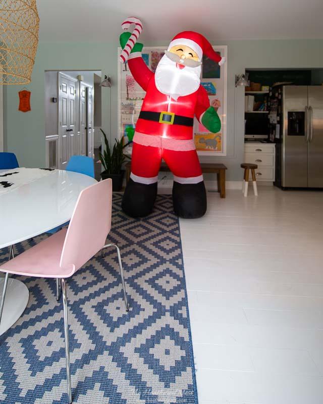 myQ smart garage hub post: 8' inflatable Santa seen in kitchen