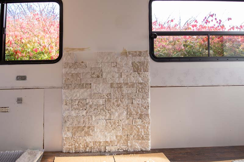 Easy enough for a novice DIY'er, install an Airstone RV Fireplace Feature wall in about a day! A great camper remodel idea!