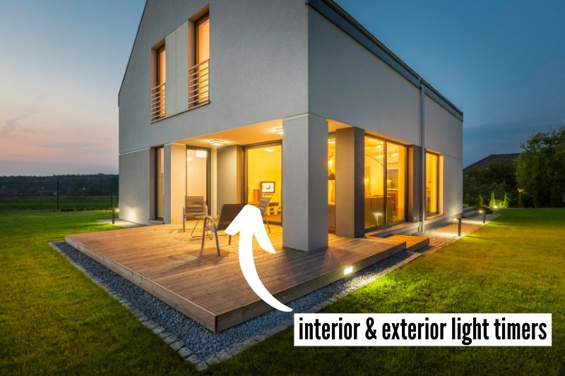19 Things To Do At Home Before You Travel Checklist - setup interior and exterior lighting timers