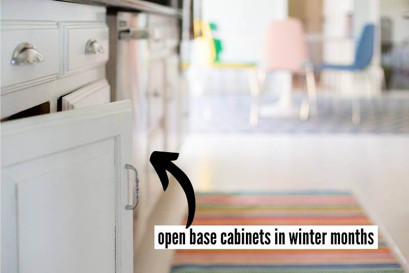 19 Things To Do At Home Before You Travel Checklist - open kitchen and bathroom base cabinets in winter