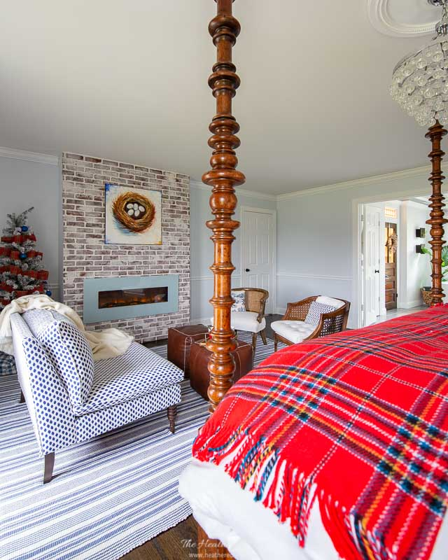blue bedroom at Christmas with red tartan throw