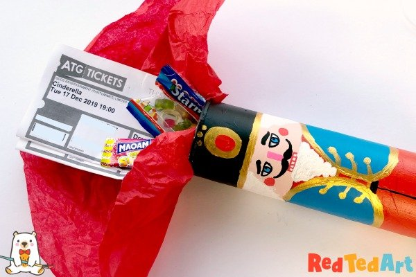 Reusable Wrapping Paper Ideas: upcycled and decorated (like a nutcracker) Pringles can