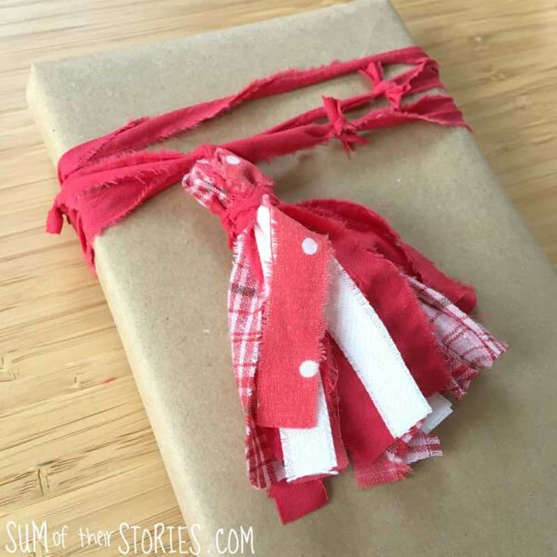 Reusable Wrapping Paper Ideas: scrap fabric turns chic ribbon tassel